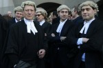 Trial lawyers demonstrate the Old Bailey courthouse in London