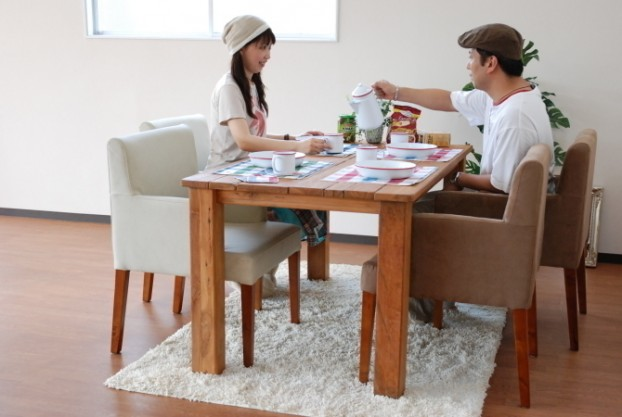An Old Wooden Dining Table Sits Within The Middle Of The Room